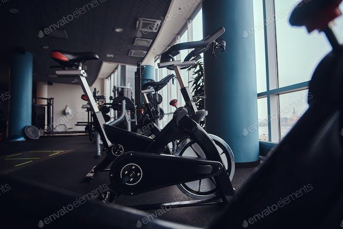 Sport, fitness, health. Exercise bikes in the fitness center.