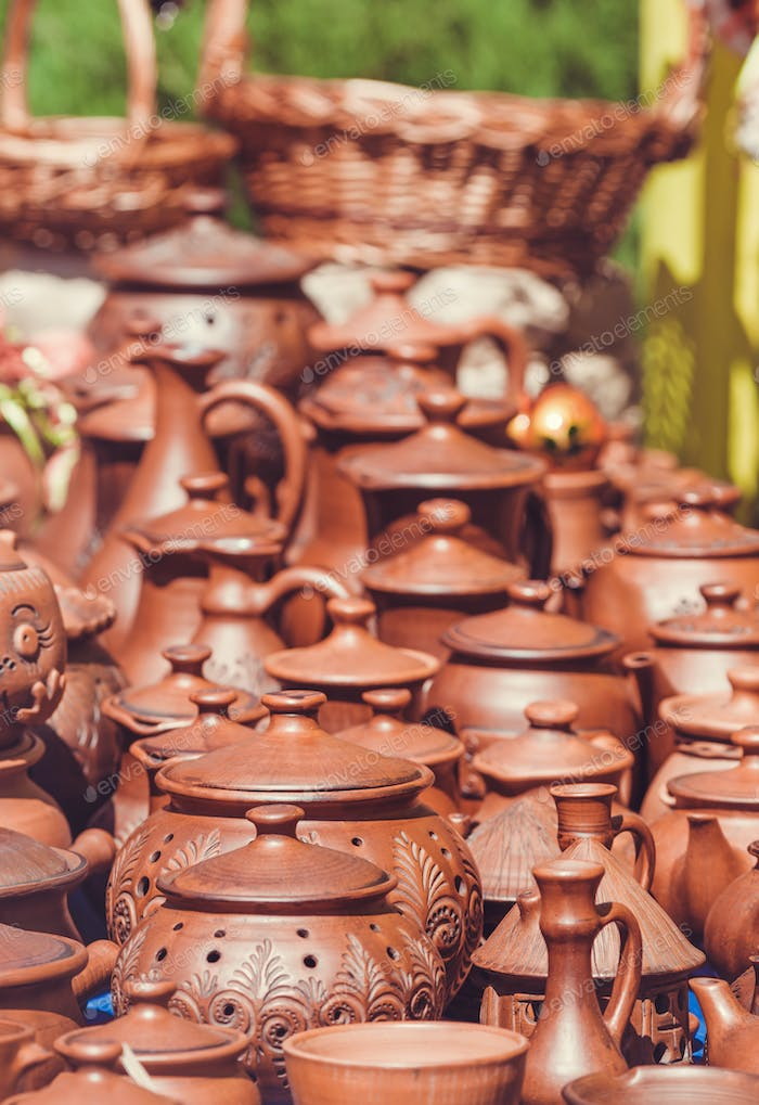 Souvenir pottery on market stand outdoor