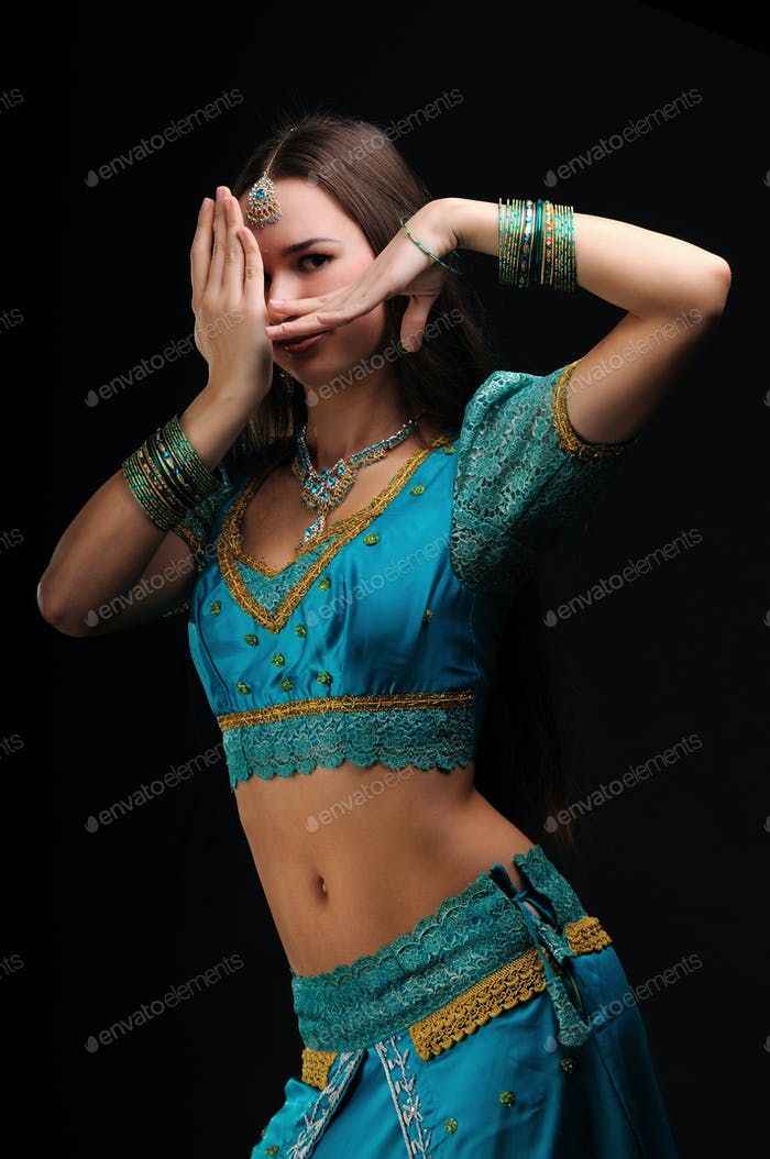 Girl in traditional indian dress shows dance movement