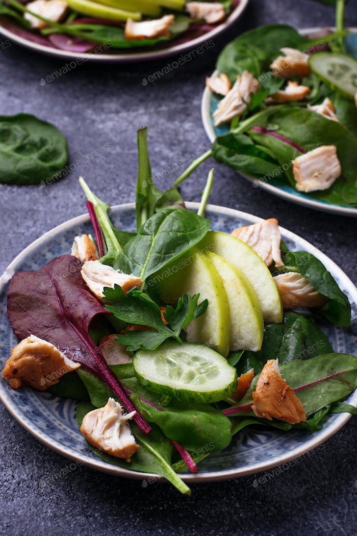 Healthy salad with chicken and apple
