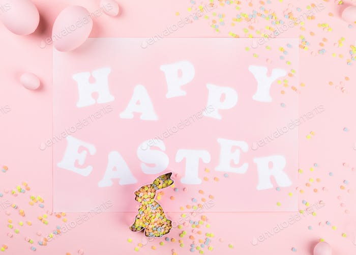 Happy Easter Greeting card with the inscription on a pink paper background.festive greetings