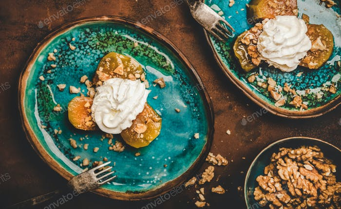 Turkish dessert with pumpkin in syrup, walnuts and whipped cream
