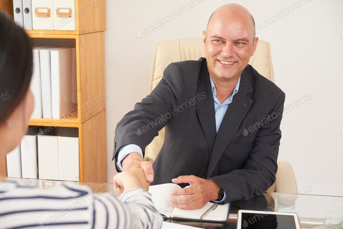Insurance agent with client