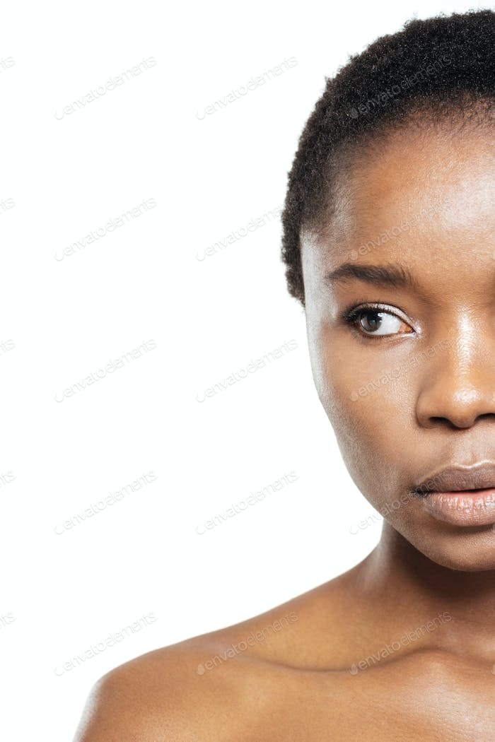 Cropped image of afro american woman looking away