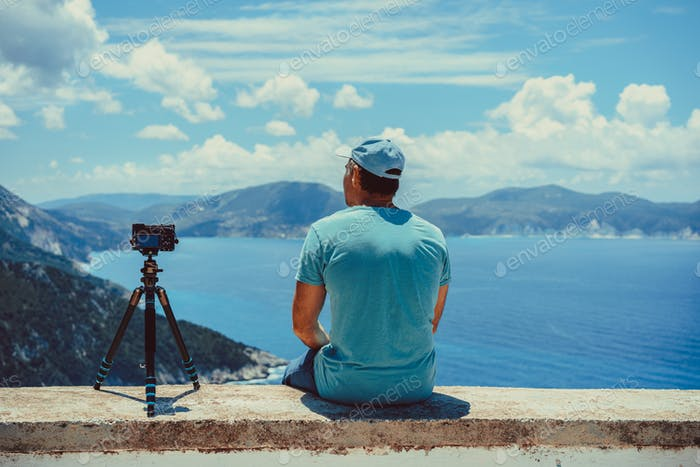 Summer holiday vocation visiting Greece. Male photographer enjoying capture time lapse moving