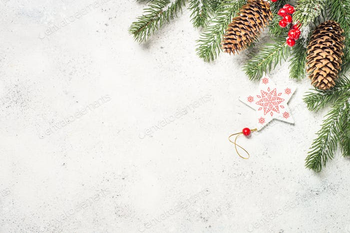 Christmas background with fir tree and decorations on white  ba
