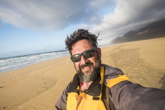 Man in the wild nature at the beach