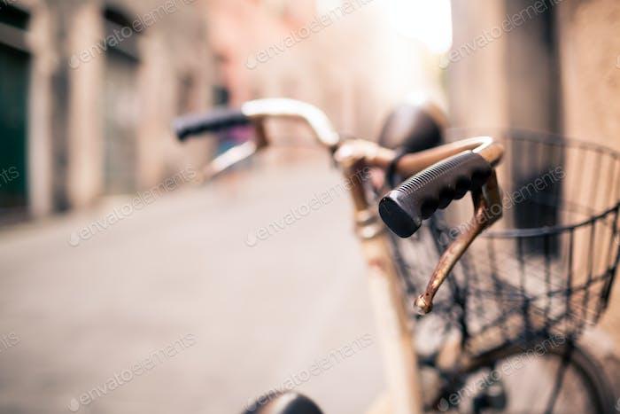 City bicycle handlebar, bike over blurred beautiful bokeh backgr