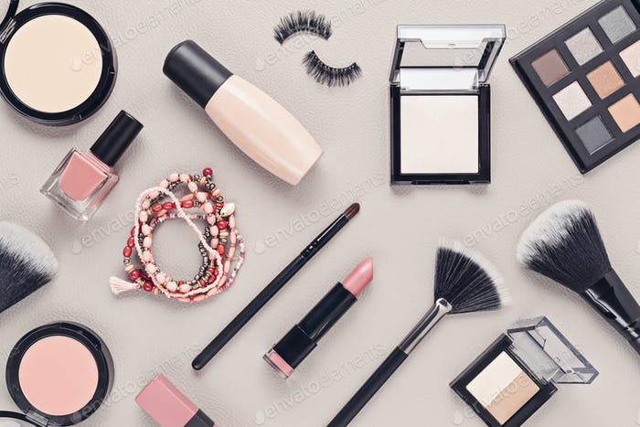Flat lay with set of professional decorative cosmetics, makeup tools and woman accessories