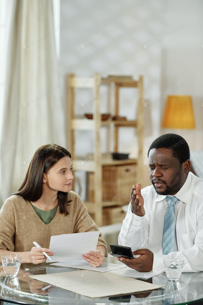 Black man advising young woman on home loan