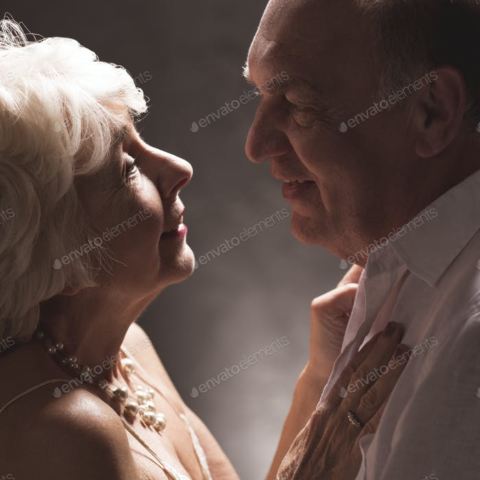 Happy elderly woman looking at lover