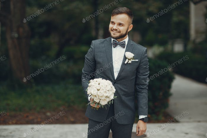 Handsome groom with flowers