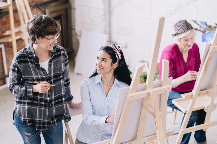 Female Art Teacher Smiling to Student