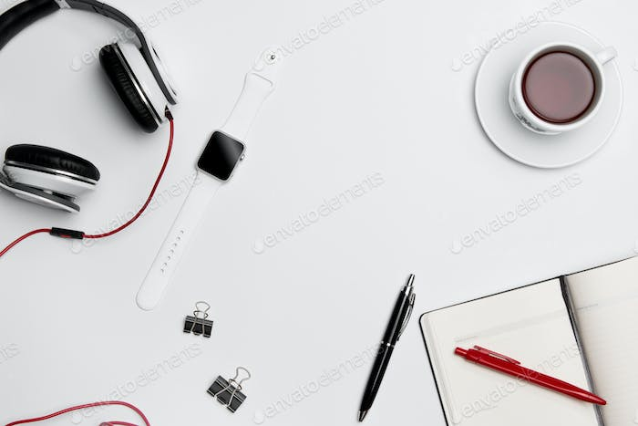 The cup, pen, and headphones on white background