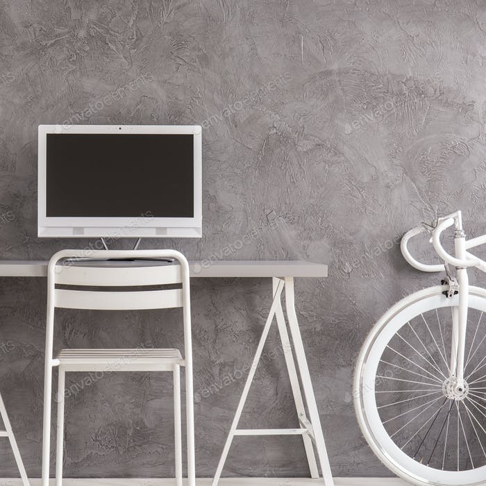 Minimalist interior with bike and desk