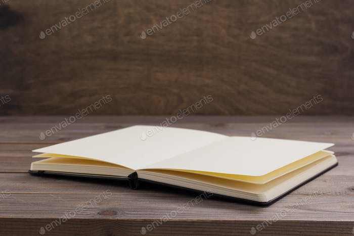 notepad or paper book at wooden table