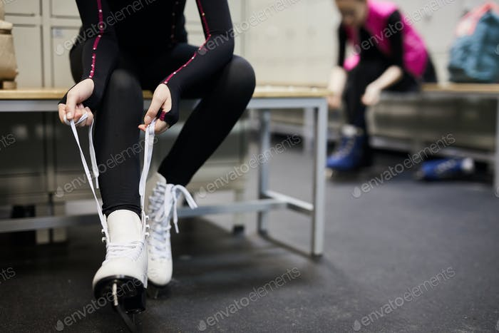Unrecognizable Girl Tying Ice Skates