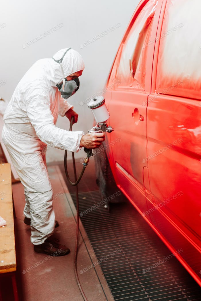 mechanic engineer painter painting a car using a car sprayer, airbrush compressor