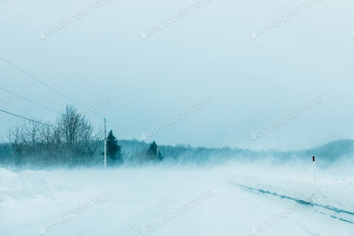 Crazy Snowstorm and Blowing Snow on the road in Canada