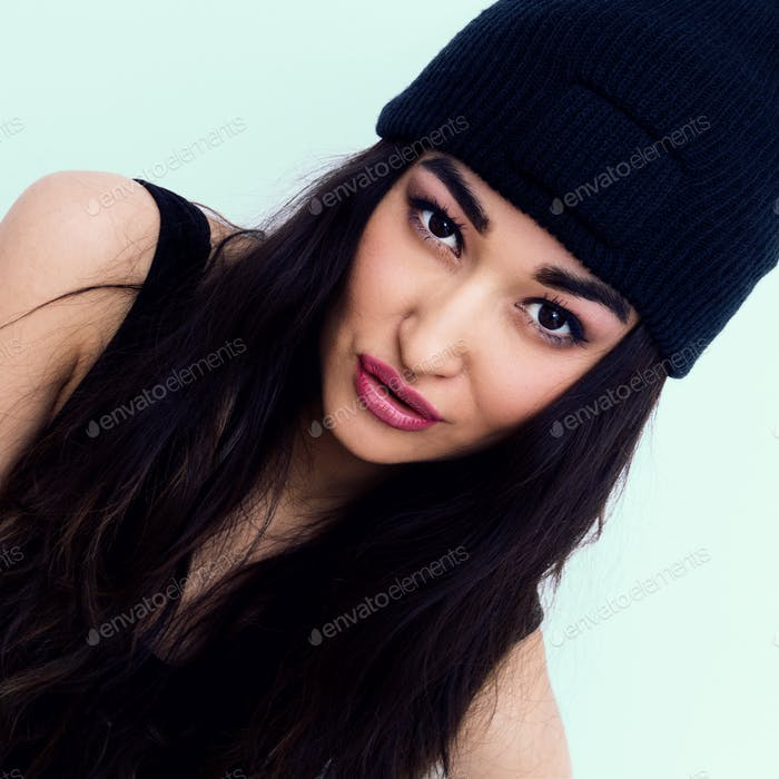 Sexy brunette in black beanie cap. Swag Urban Style