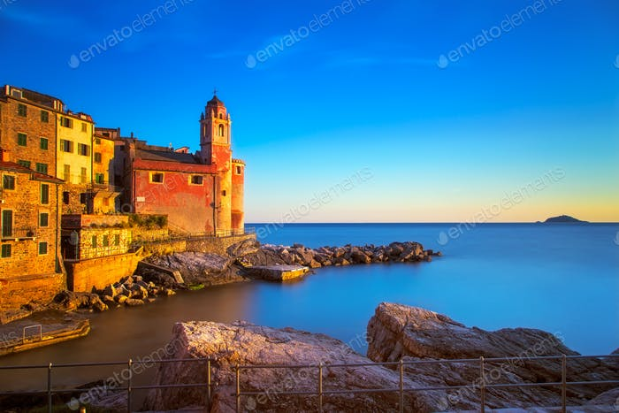 Tellaro rocks, church and village on sunset. Cinque terre, Ligur