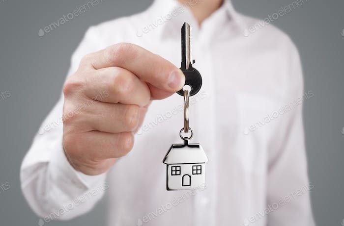 Giving house key on keychain