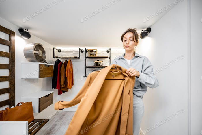 Woman in the wardrobe at home