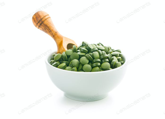 Healthy chlorella pills or green barley pills.