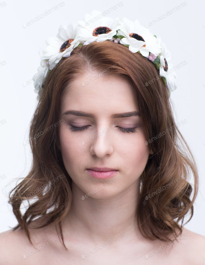 Portrait of a attractive young woman with closed eyes