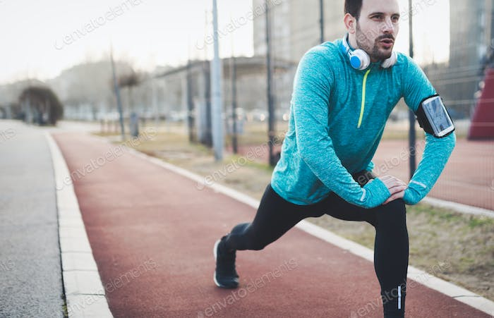 Handsome man stretching before exercising
