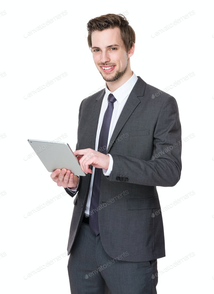Confident businessman use of tablet pc