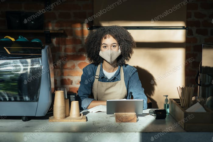 Modern technology for work during social distance and coronavirus quarantine in cafe