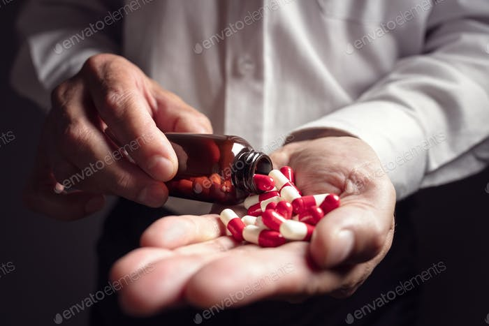 Taking prescription medicine pills