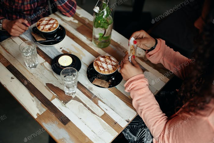 Women at restaurant with two cup of coffee