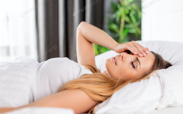 Sick woman suffering headache after bad night