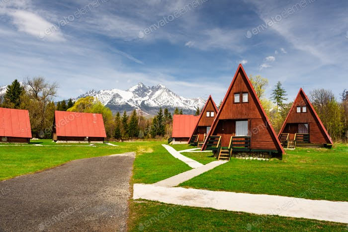 Camping with red wooden houses in Tatra Mountains