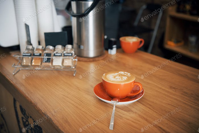 Cup of coffee latte on wood bar