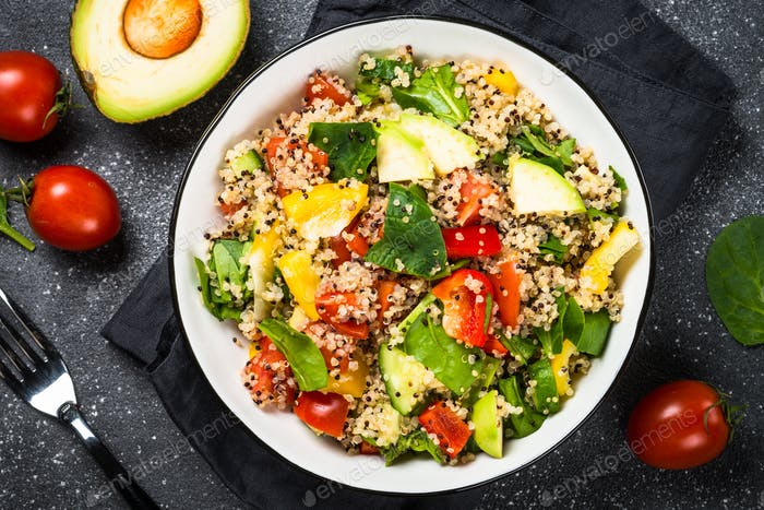Quinoa salad with fresh vegetables on black