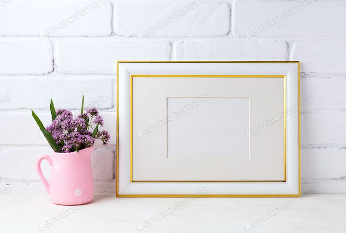 Gold decorated landscape frame mockup with purple flowers in pin