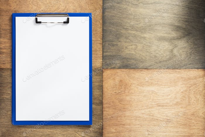 paper clipboard at wooden background