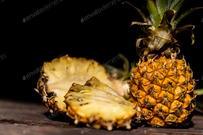 Pineapples on a dark wooden background