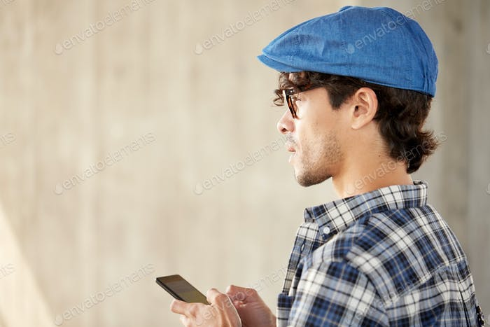 close up of man texting message on smartphone