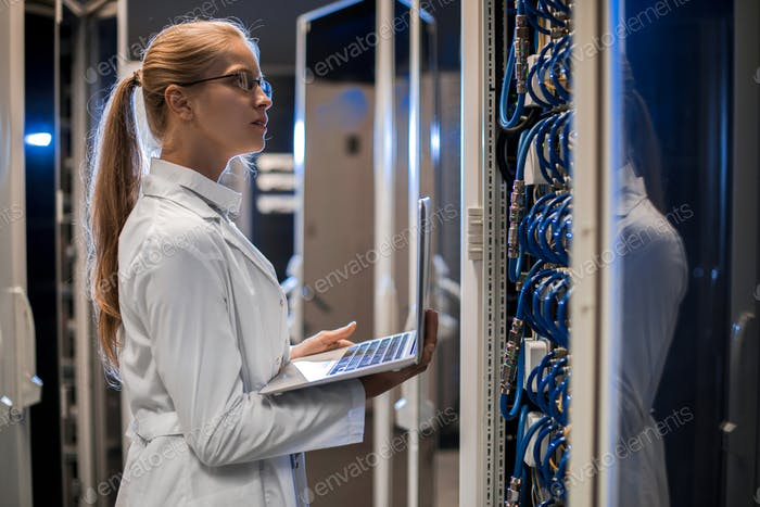 Female Scientist Working with Supercomputer