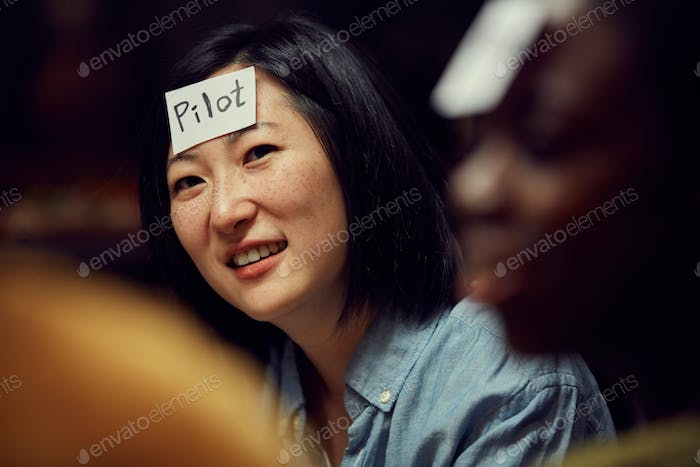 Asian Woman Playing Guessing Game