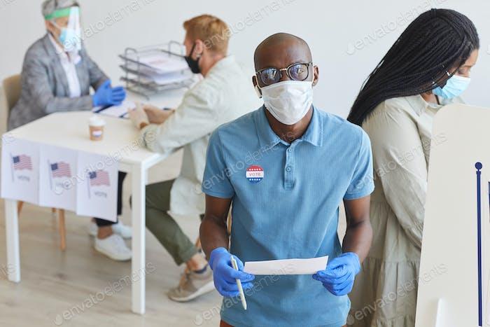 African-American Man Voting in Pandemic