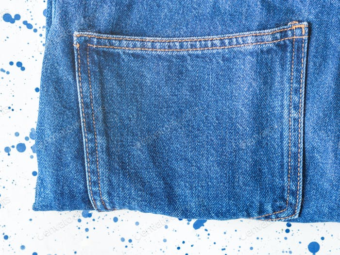 Pair of denim jeans on white background