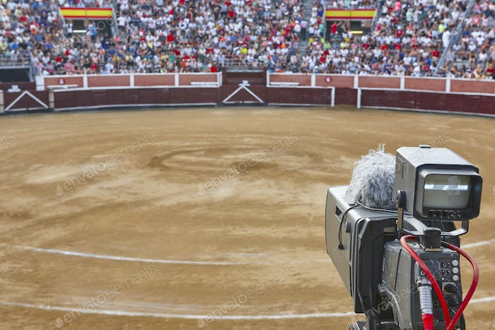 Tv set on a bullring filled with people. Bullfighting, Spain