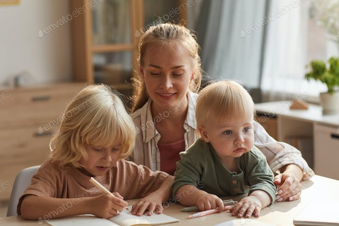 Child doing homework with mum