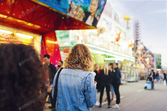 Woman walking in amusement park