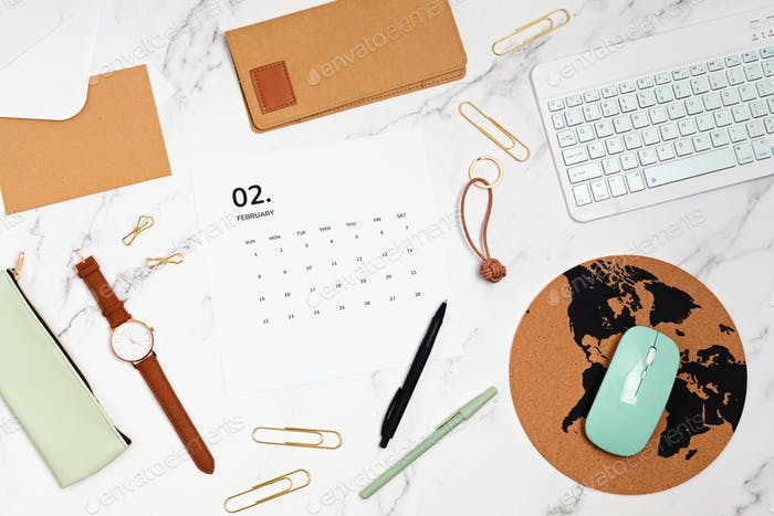Desktop with calendar for february and office supplies. home office, social media blog